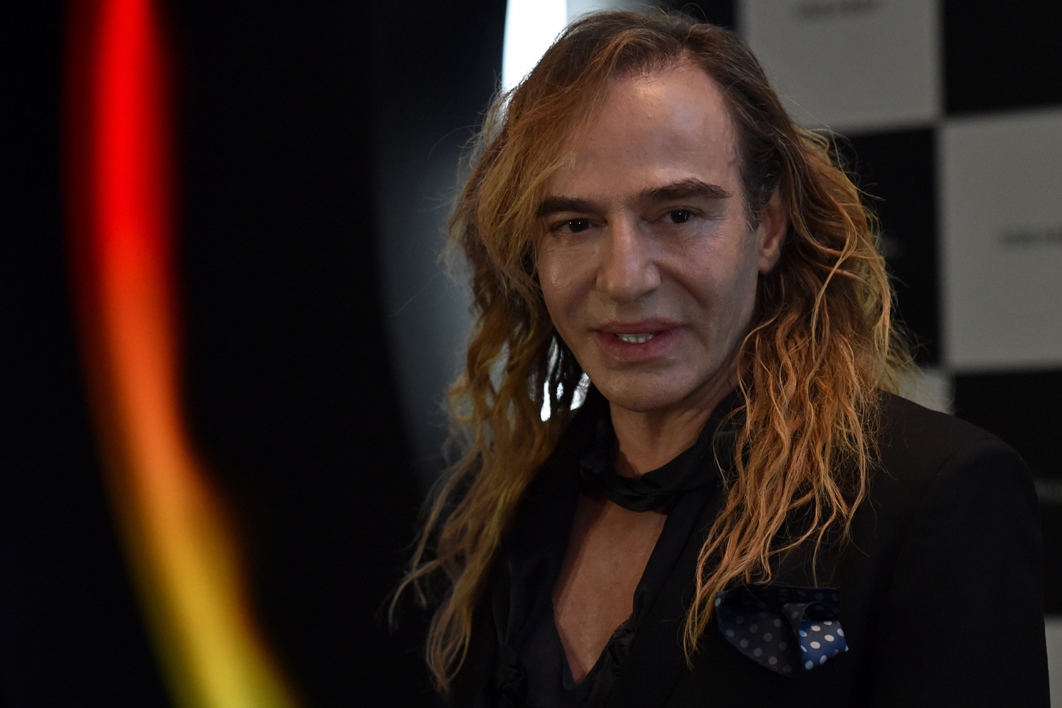 British designer John Galliano gives a press conference on his new work as a consultant for Russian cosmetics retailer L'Etoile in at the Barvikha Luxury Village Concert Hall just outside Moscow, on May 22, 2014. Galliano, who was ousted from fashion house Dior over an anti-Semitic outburst, landed himself a new job in Russia as a consultant for L'Etoile. AFP PHOTO / KIRILL KUDRYAVTSEV (Photo credit should read KIRILL KUDRYAVTSEV/AFP/Getty Images)