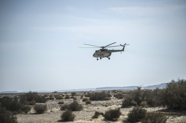 An Egyptian army helicopter flies over the crash site of an A321 Russian airliner in Wadi al-Zolomat, a mountainous area in Egypt's Sinai Peninsula, on November 1, 2015. International investigators began probing why the Russian airliner carrying 224 people crashed in the Sinai Peninsula, killing everyone on board, as rescue workers widened their search for missing victims. AFP PHOTO / KHALED DESOUKI (Photo credit should read KHALED DESOUKI/AFP/Getty Images)