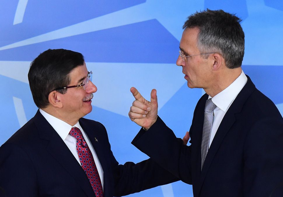 Turkish Prime Minister Ahmet Davutoglu (L) and NATO Secretary General Jens Stoltenberg speak before a press conference at the NATO headquarters on November 30, 2015 in Brussels. (EMMANUEL DUNAND/AFP/Getty Images)