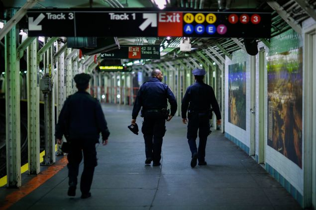 NEW YORK, NY - DECEMBER 31: New York Police Officers patrol on foot the subway station of Times Square before New Year's Eve celebrations on December 31, 2015 in New York City. At least 6,000 police officers has being deployed in one of the biggest security deployments made in the city, where rooftop snipers, canine units and air and water patrols will also be on duty around Times Square in what New York City Mayor Bill de Blasio said 'the best prepared city to prevent terrorism and to deal with any event that could occur.' (Photo by Eduardo Munoz Alvarez/Getty Images)