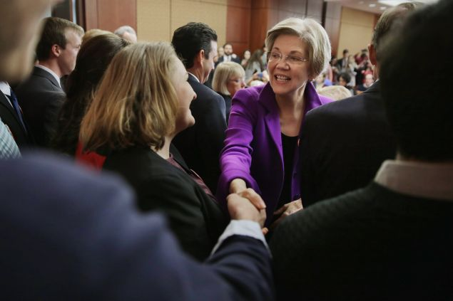 "Sen. Elizabeth Warren greets college students before a news conference to unveil a legislative package to address college affordability in the U.S. Capitol Visitors Center College January 21, 2016 in Washington, DC. The Democratic senators hope to ""put America on path toward debt-free college education."""