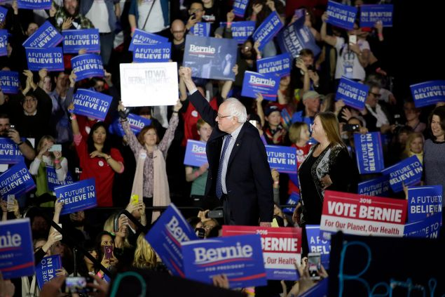 Sen. Bernie Sanders acknowledges the crowd before speaking during his Caucus night event in Des Moines, Iowa. (Photo: Joshua Lott/Getty Images)