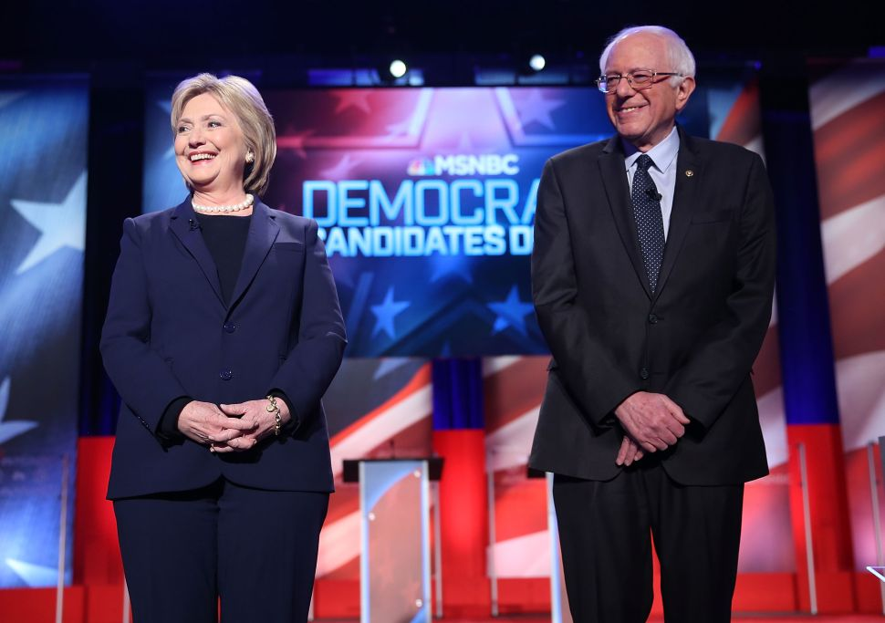 DURHAM, NH - FEBRUARY 04: Democratic presidential candidate former Secretary of State Hillary Clinton and U.S. Sen. Bernie Sanders (I-VT) stand next to each other at the start of their MSNBC Democratic Candidates Debate at the University of New Hampshire on February 4, 2016 in Durham, New Hampshire. This is the final debate for the Democratic candidates before the New Hampshire primaries.Ê (Photo by Joe Raedle/Getty Images)