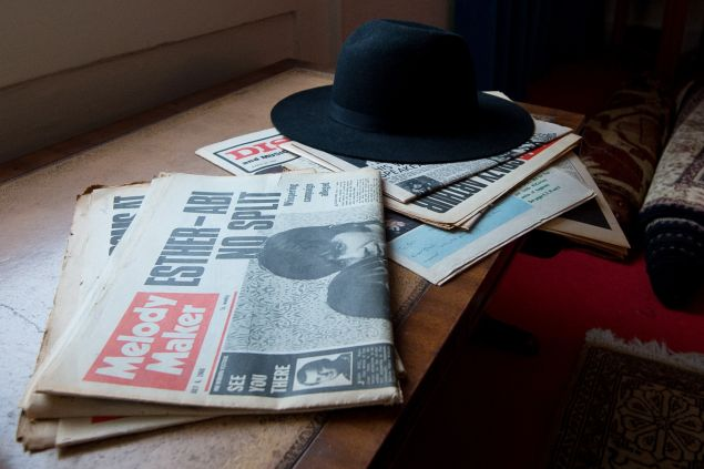 A selection of newspapers and hat is displayed in a recreation of Jimi Hendrix's bedroom.