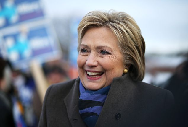 NASHUA, NH - FEBRUARY 09: Democratic presidential candidate former Secretary of State Hillary Clinton greets voters outside of a polling station at Fairgrounds Junior High School on February 9, 2016 in Nashua, New Hampshire. New Hampshire voters are heading to the polls in the nation's first primaries. (Photo by Justin Sullivan/Getty Images)