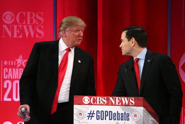 Republican presidential candidates Sen. Marco Rubio listens to Donald Trump during a break of a CBS News GOP Debate February 13 at the Peace Center in Greenville, South Carolina. (Photo: Spencer Platt/Getty Images)