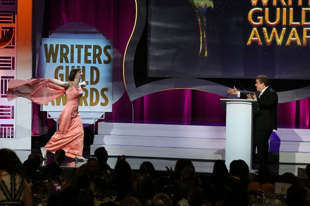 Kristen Schaal runs to West Coast host Patton Oswalt during the 2016 Writers Guild Awards.