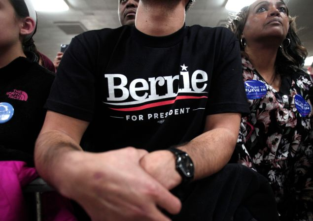 People listen to Democratic presidential candidate, U.S. Sen. Bernie Sanders speak at a campaign rally at United Auto Workers Union Local 600 February 15 in Dearborn, Michigan.