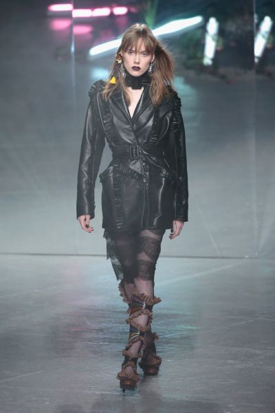 The opening look, a leather coat
