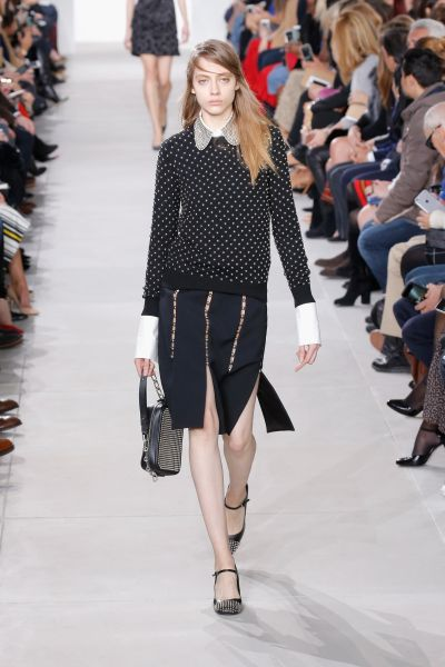 Studded Cashmere Sweater, $1,295, Julie Small Studded Leather Camera Bag, $1,550, and Bess Studded-Leather Pump, $895, All at Michaelkors.com