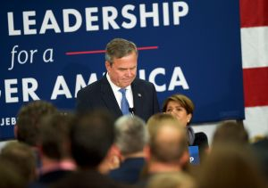 Jeb Bush reacts as he announces the suspension of his presidential campaign .