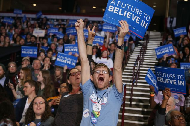 People cheer as they attend a rally for Democratic presidential candidate Sen. Bernie Sanders (D-VT) at the Bon Secours Wellness Arena on February 21, 2016 in Greenville, South Carolina. Sanders and Hillary Clinton continue to battle for the votes of primary voters as South Carolina holds their Democratic primary on February 27th.