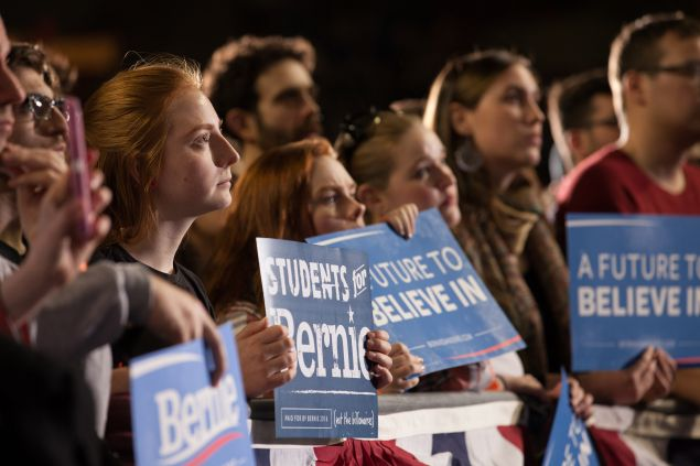 Attendees listen as democratic presidential candidate, Sen. Bernie Sanders (D-VT) speaks at a rally on February 22, 2016 at the University of Massachusetts in Amherst, Massachusetts. Sanders is campaigning in the lead up to Super Tuesday primaries on March 1 when 11 states will vote.