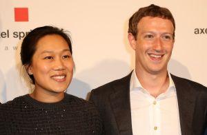 Mr. Zuckerberg (right) and his wife, Priscilla Chan.