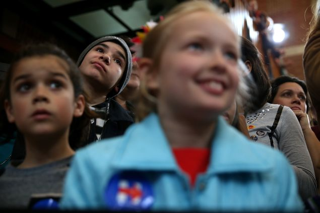 """Young supporters look on as democratic presidential candidate former Secretary of State Hillary Clinton speaks during a """"Get Out The Vote"""" rally at the Lyman & Merrie Wood Museum of Springfield History on February 29, 2016 in Springfield, Massachusetts. Hillary Clinton is campaigning in Massachusetts and Virginia ahead of Super Tuesday."""