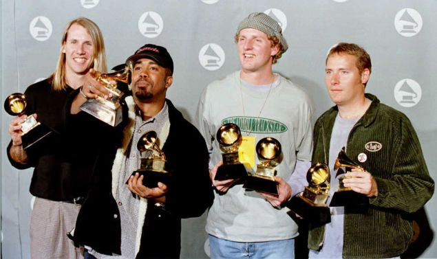 "Hootie and the Blowfish pose for photographers with their Grammy for Best New Artist and Best Pop Performance by a Group with Vocal for ""Let Her Cry"" at the 38th Annual Grammy Awards in Los Angeles, February 28, 1996."