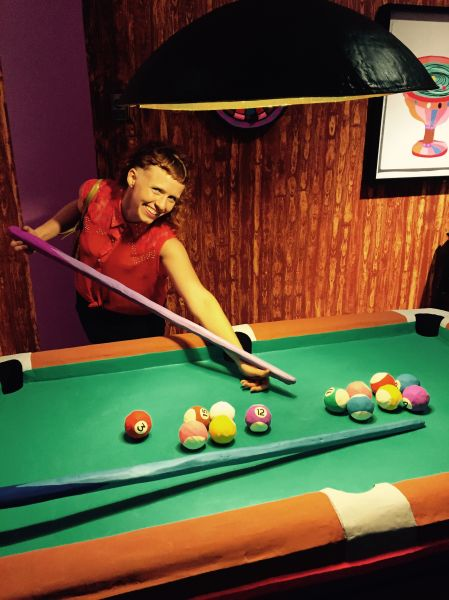 Artist Macon Reed plays pool inside her installation Eulogy for the Dyke Bar, 2015.
