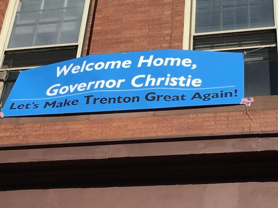 A banner in Trenton unfurled outside the office of Assemblyman Reed Gusciora (D-15).