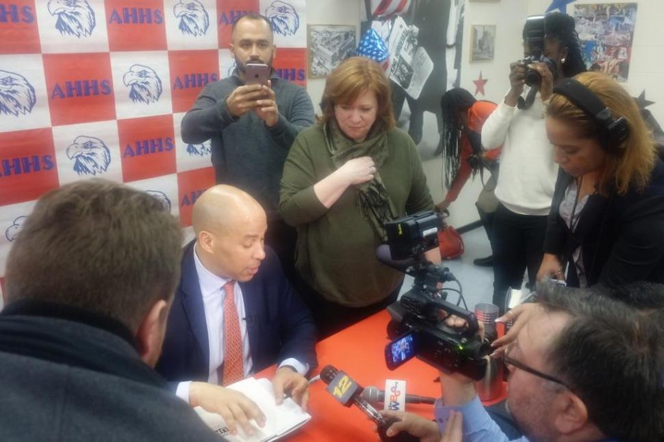 Booker at a book signing yesterday in Newark.