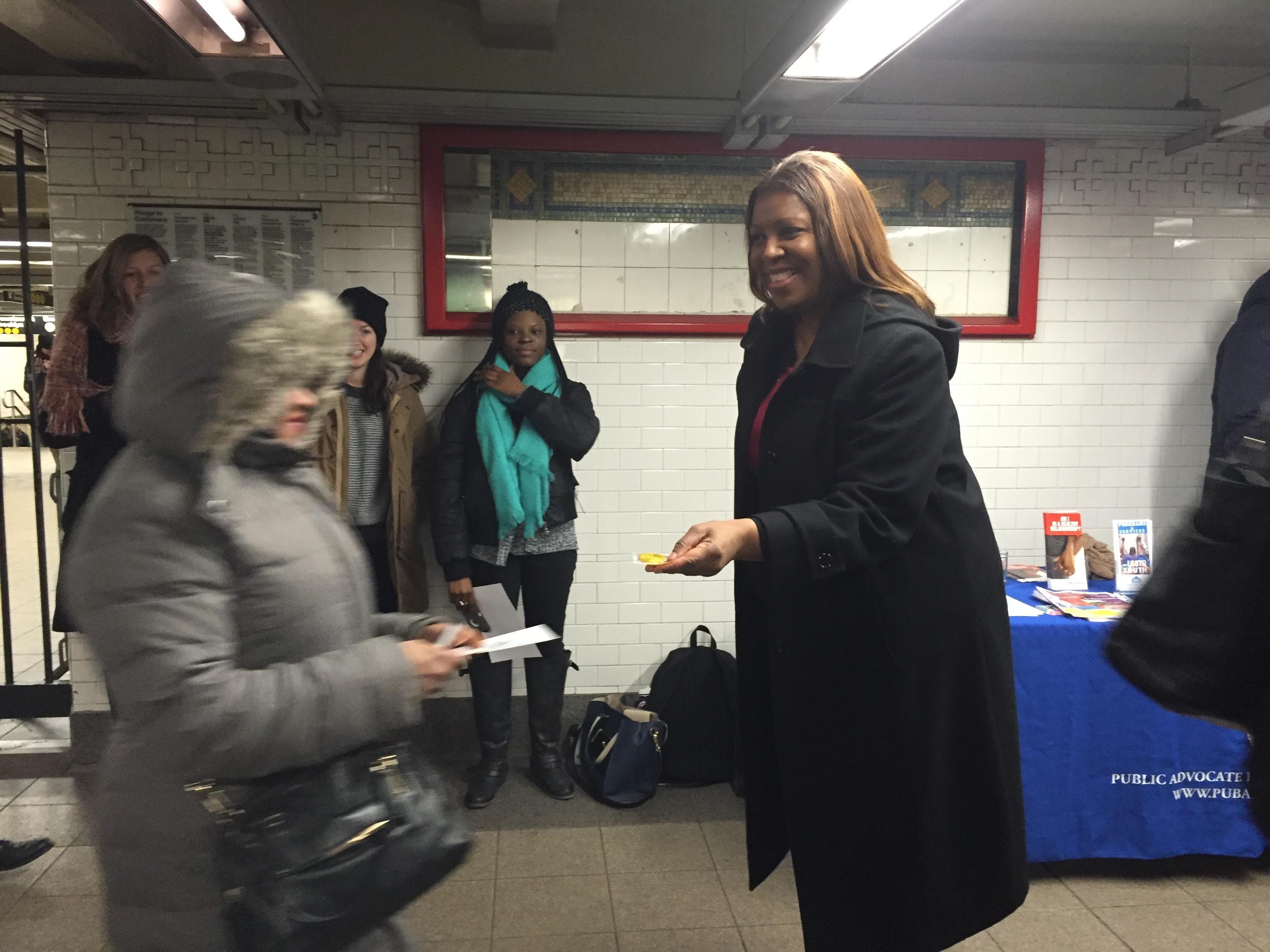 Public Advocate Letitia James hands out free condoms in the Union Square subway station. (Photo: Jillian Jorgensen for Observer)