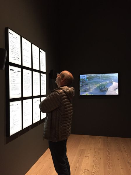 "A visitor to Laura Poitras' ""Astro Noise"" at the Whitney Museum. (New York Observer)"