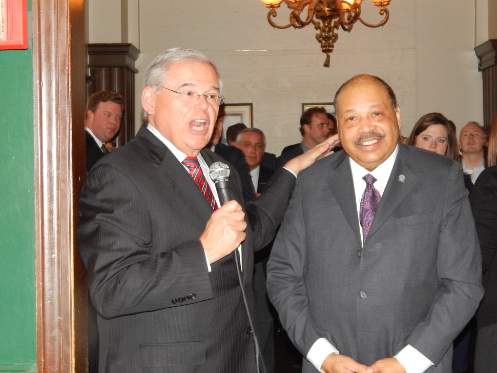 Menendez, left, and Democratic State Committee Chairman John Currie.