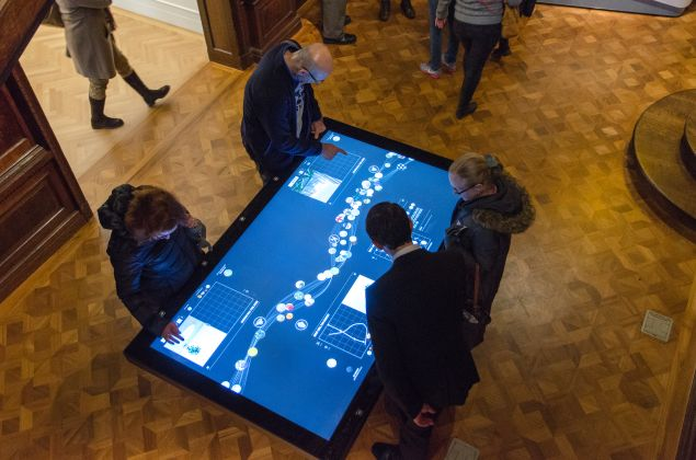 Interacting with the collection on the museum's digital tables. (Photo: Local Projects)