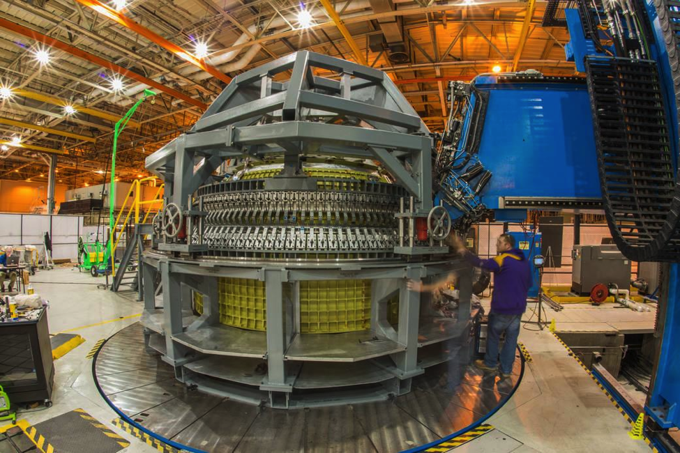 The Orion crew module pressure vessel being welded inside NASA's Michoud Assembly Facility. (Credit: NASA)