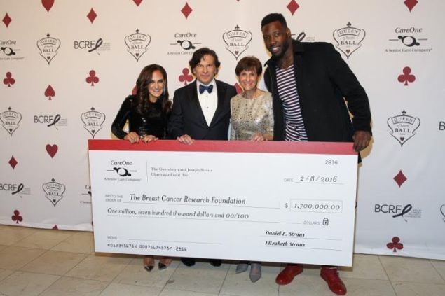 Elizabeth Straus, Daniel E. Straus, Myra Biblowit, and Jason Pierre-Paul pose with $1.7 million check at CareOne's Queen of Hearts Ball and Casino Night at Guastavino's, on Tuesday, Feb. 9, 2016 in New York. (Photo by Mark Von Holden/AP Images for CareOne Management LLC)