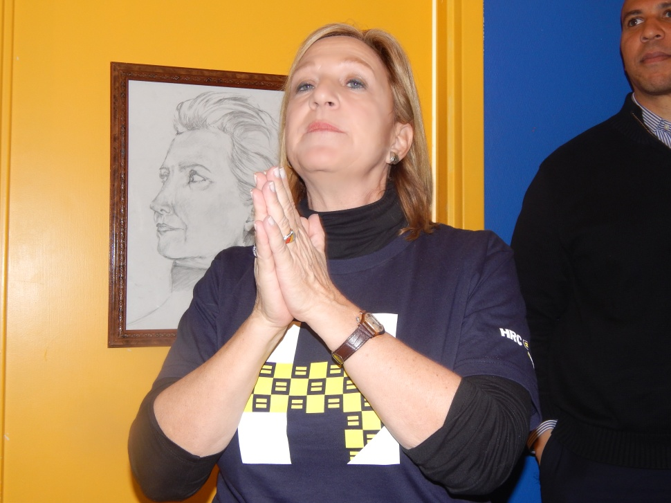 PRAYING FOR A HILLARY WIN - No, not really. Vainieri Huttle was speaking to volunteers in Clinton's Manchester headquarters on Saturday in this candid shot, not trying to summon divine intervention.