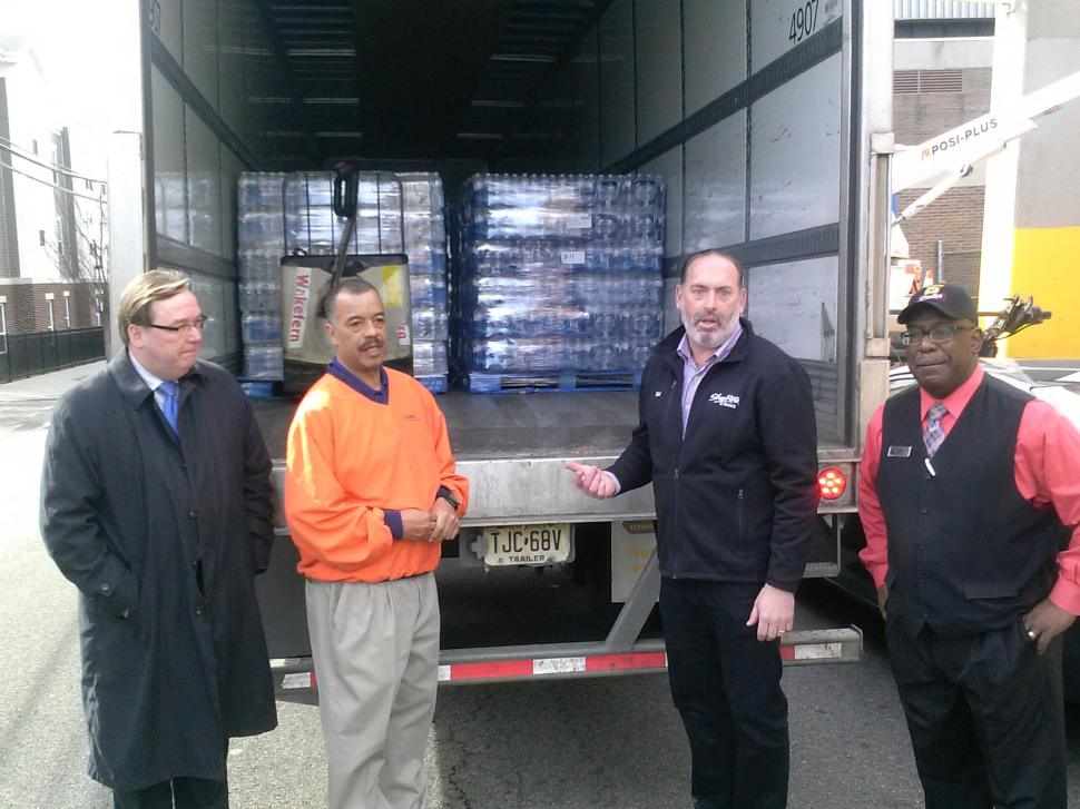 Newark ShopRite owner Neil Greenstein, second from right; and Newark Councilman Eddie Osborne, second from left, prepare to offload ShopRite-donated water at the JFK Recreation Center in the Central Ward last week as the city confronted a schools' drinking water crisis.