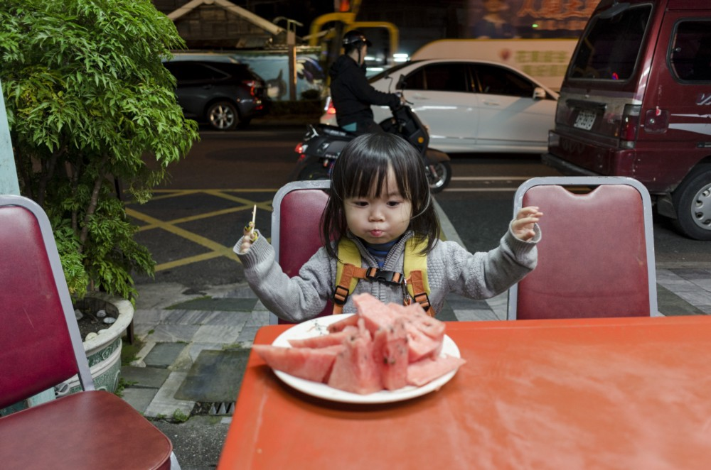 Little Chow loves her watermelon. Just like her father.