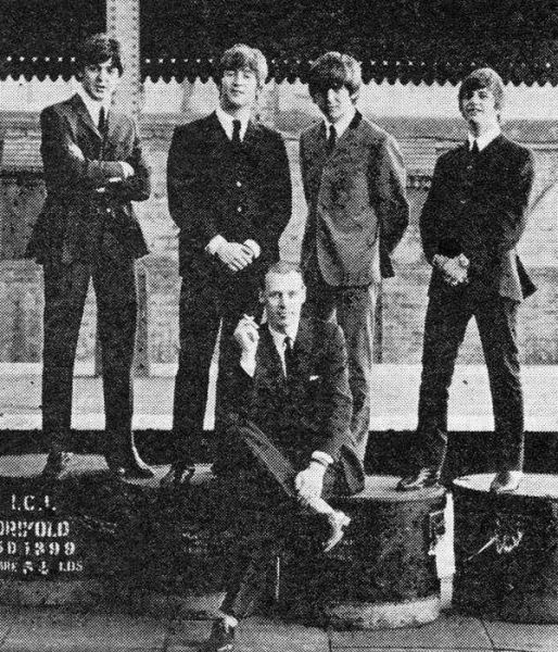 George Martin and the Beatles.