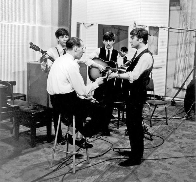 The Beatles with George Martin in the studio.