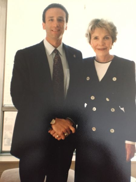 Author Scott Alswang of the USSS shakes hands with Nancy Reagan, who he occasionally protected in New York.