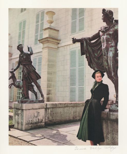 Model wearing the Mystère coat by Christian Dior in Paris at Malmaison, color proof, featured in Harper's Bazaar, November 1947. Photograph by Louise Dahl-Wolfe. Collection of The Museum at FIT, © 1989 Center for Creative Photography, Arizona Board of Regents.