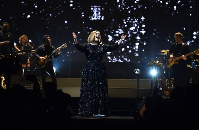 Adele performing in her Burberry dress