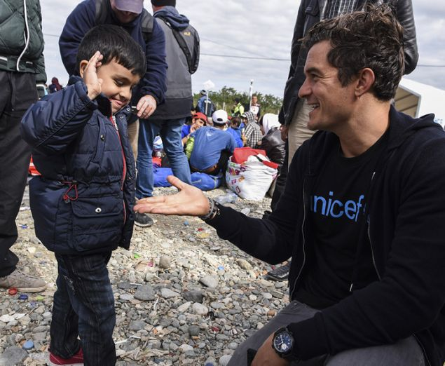Orlando Bloom visiting a refugee camp in Macedonia in 2015.