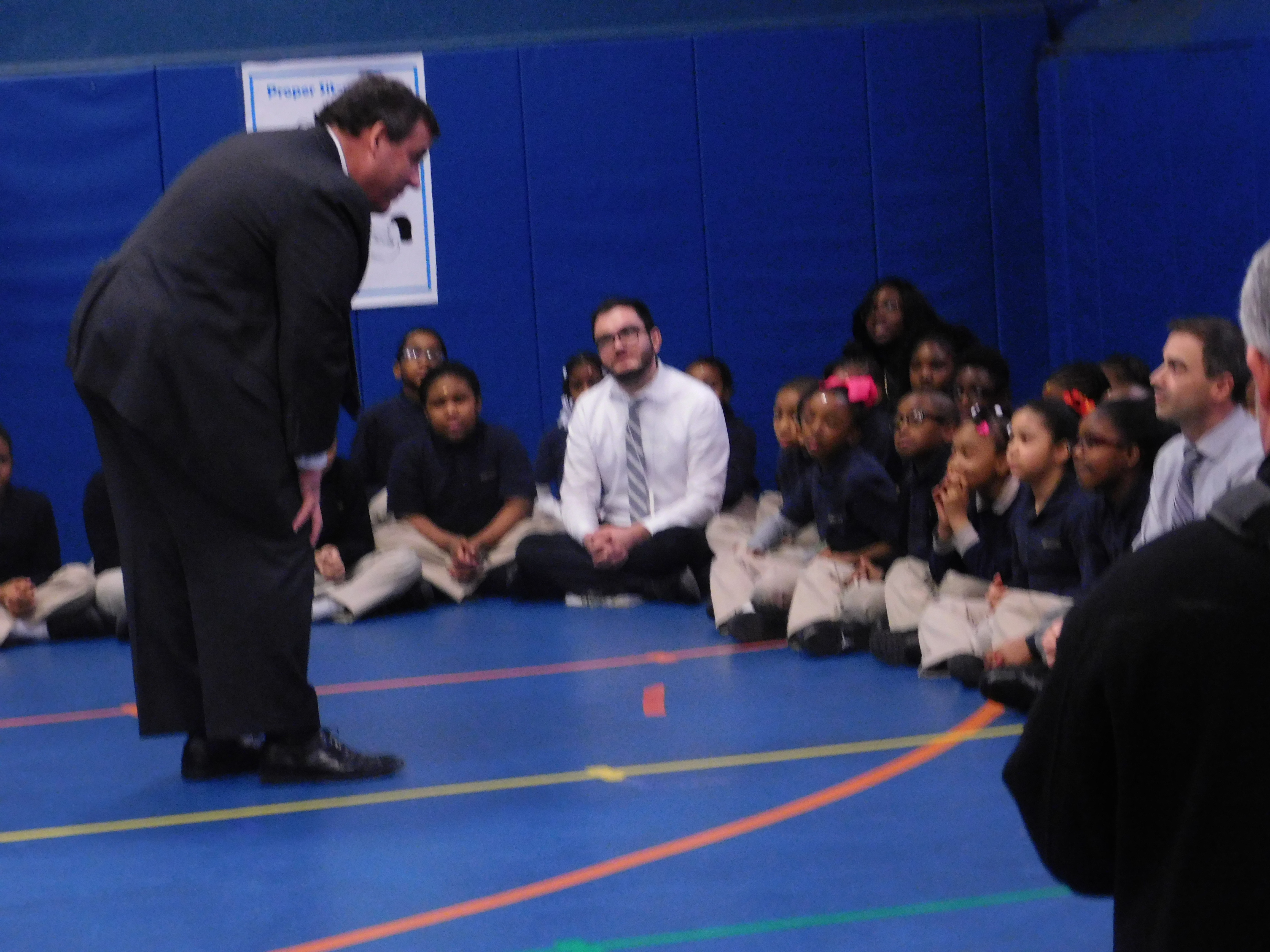 Christie talks to an elementary school student.