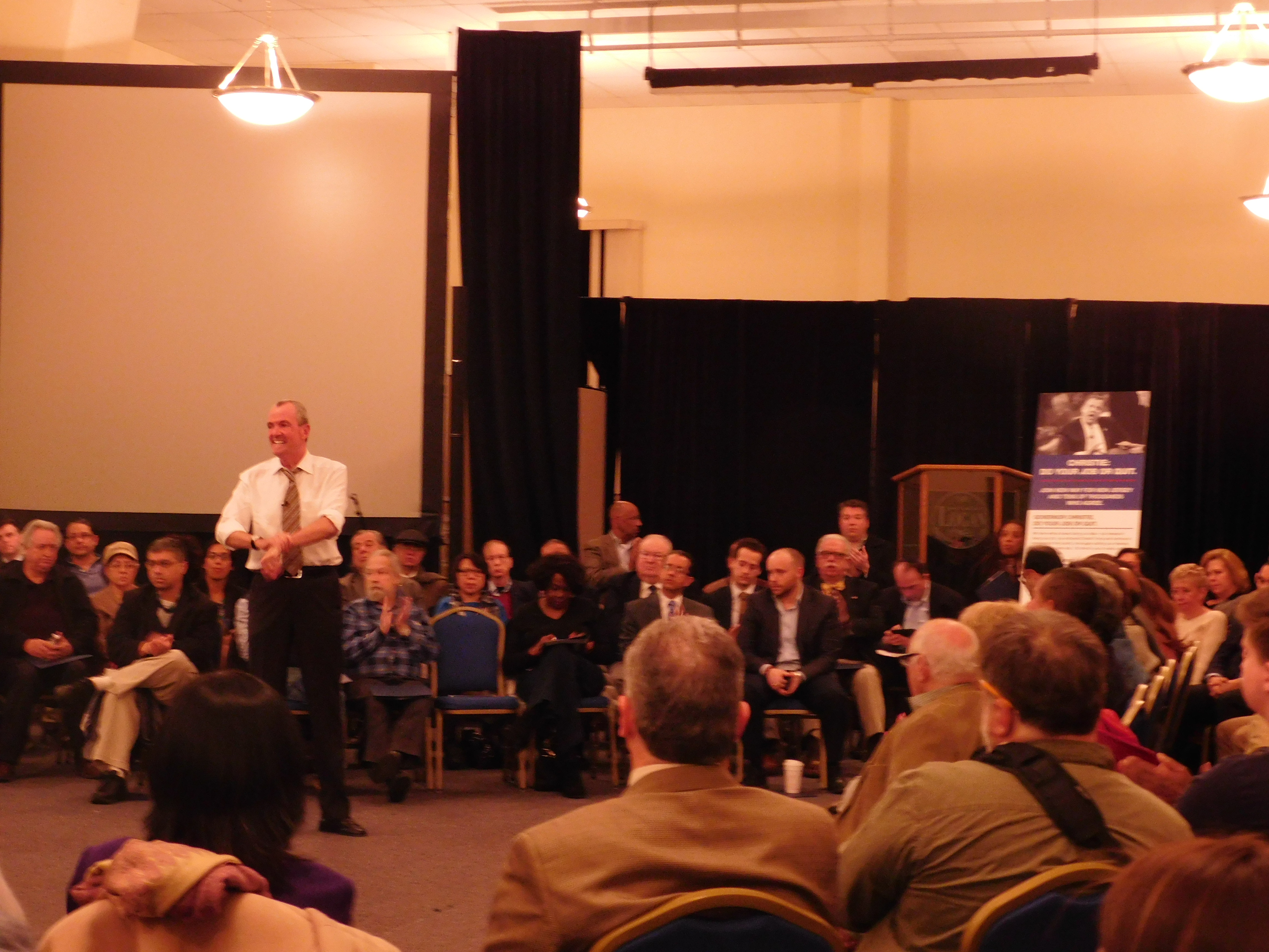 Murphy speaks to the crowd at a town hall event.
