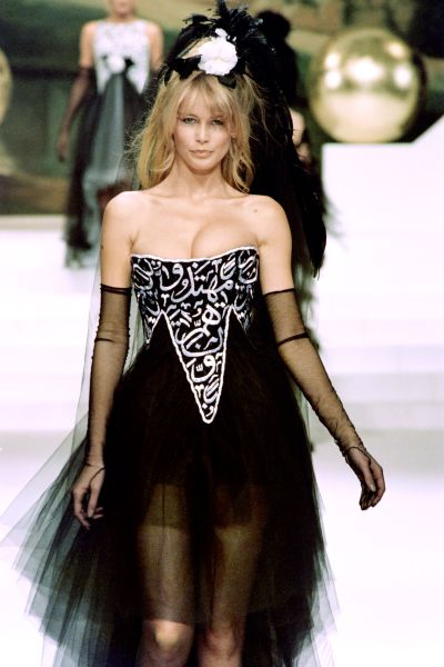 Model Claudia Schiffer in Karl Lagerfeld with verses from the Koran, January 1994
