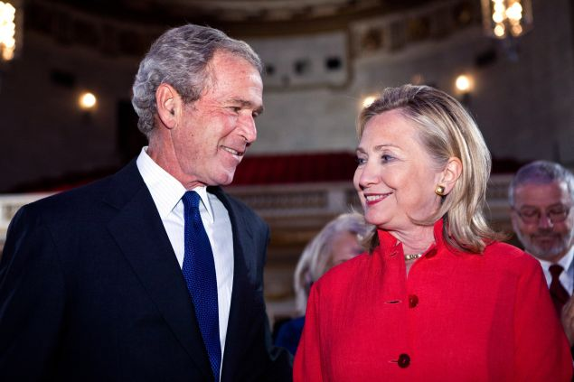 Former President George W. Bush (L) and Secretary of State Hillary Clinton arrive at the Summit to Save Lives on September 13, 2011 in Washington, DC. The event introduced a new initiative to screen women in developing countries for cervical and breast cancer.