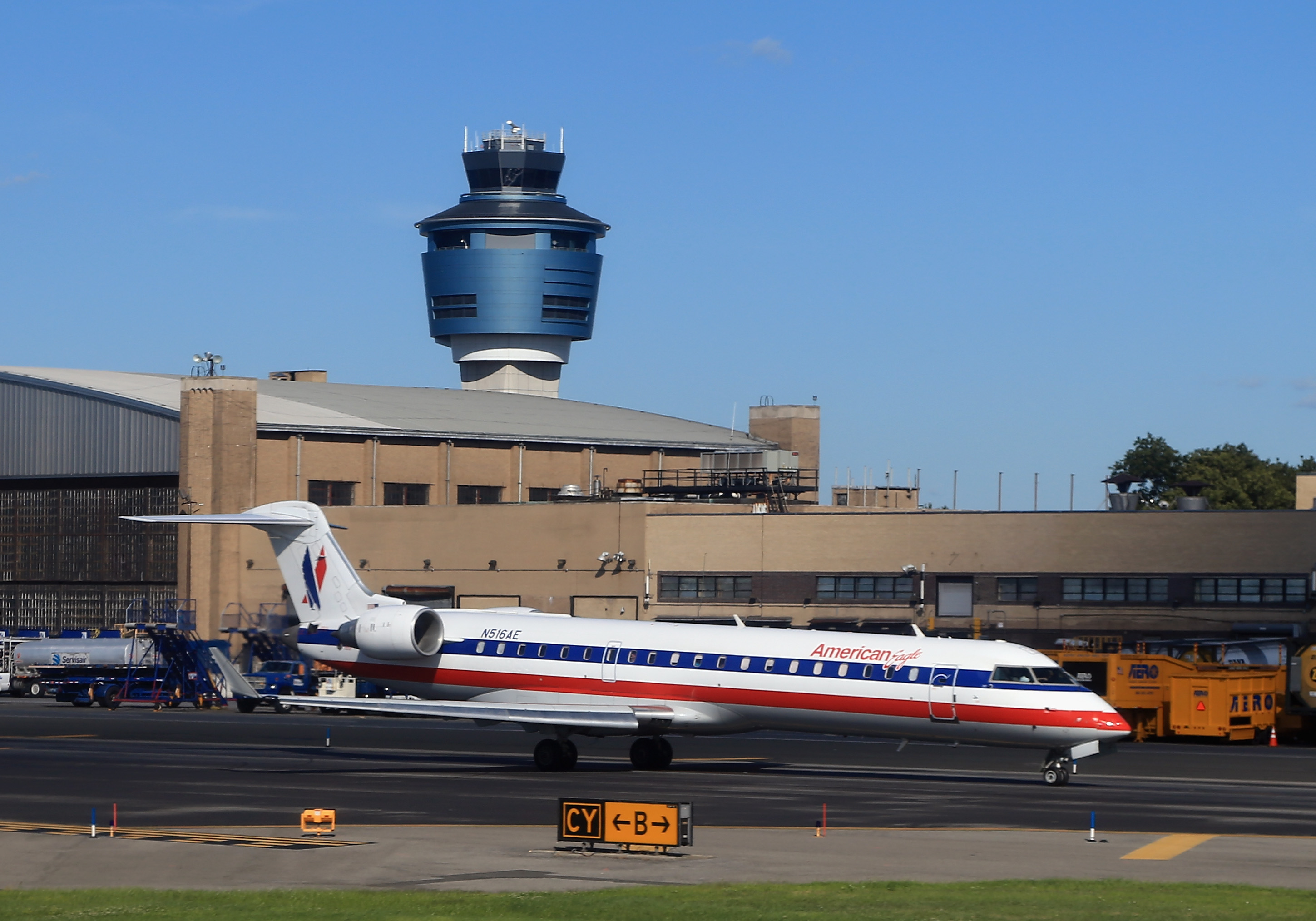 An American Airlines jet taxis on the runway at Laguardia Airport on August 14, 2013 in New York, New York.