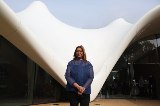 LONDON, ENGLAND - SEPTEMBER 25: Architect Zaha Hadid poses for a photograph in front of the redeveloped Serpentine Sackler Gallery in Hyde Park on September 25 2013 in London, England. The renovation of the 1805 gunpowder store, located on the north side of the Serpentine Bridge, was designed by Zaha Hadid Architects. The new gallery, restaurant and social space will officially open to the public on September 28, 2013.