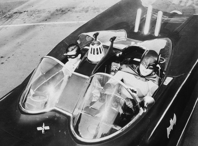 American actors Burt Ward (left), as Robin, and Adam West, as Batman, ride in the Batmobile in a still from the television series, 'Batman,' c. 1967.