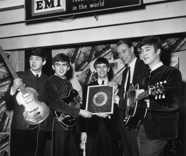 April 8, 1963: British pop group The Beatles holding their silver disc. Left to right are, Paul McCartney, George Harrison (1943 - 2001), Ringo Starr, George Martin of EMI and John Lennon (1940 - 1980).