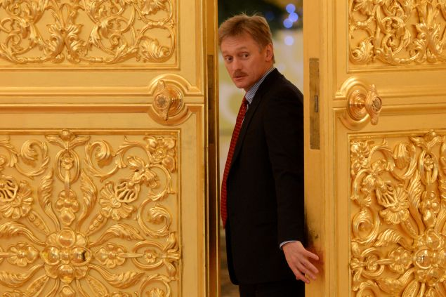 Vladimir Putin's spokesman Dmitry Peskov attends a meeting in the Kremlin in Moscow, on December 25, 2013.