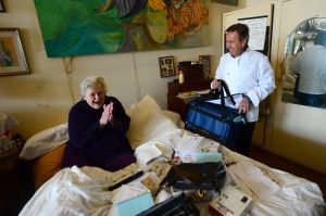 Three-star Michelin chef Daniel Boulud delivers a meal cooked at one of his restaurant to Wilda, 86, as part of Citymeals-on-Wheels.