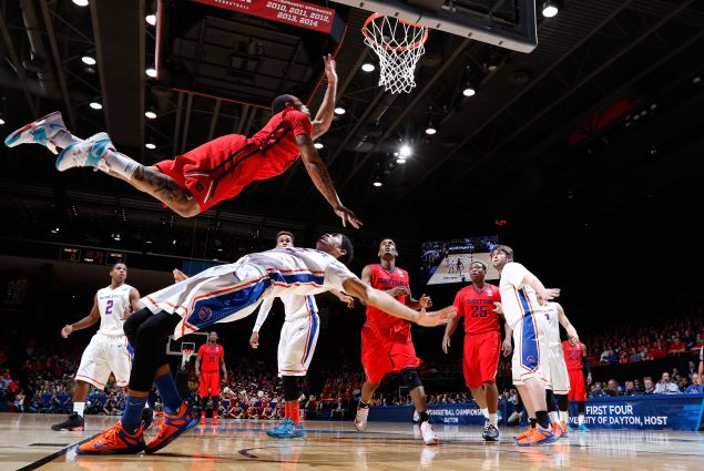 Kyle Davis #3 of the Dayton Flyers goes to the basket against Chandler Hutchison #15 of the Boise State Broncos during the first round of the 2015 NCAA Men's Basketball Tournament on March 18, 2015 in Dayton, Ohio.