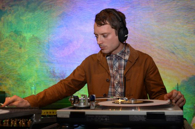 AUSTIN, TX - MARCH 18: Elijah Wood performs during the Marshall Headphones secret and intimate speakeasy pop-up party at the SXSW 2015 music festival in Austin, Texas, together with No Name and A-OK Collective with guests and live acts such as Elijah Wood, The Drums, The Strokes, Zach Cowie, Io Echo, Letts, Mystery Lights, Alberta Cross, Summer Moon, Night Terrors of 1937, the WIllie Nelson tour bus and more, on March 18, 2015 in Austin, Texas. (Photo by Daniel Boczarski/Getty Images for Marshall Headphones)